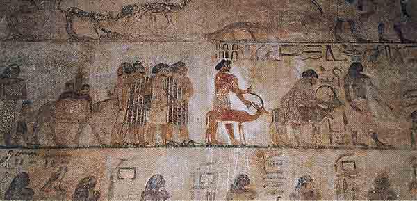 Роспись гробницы из Бени-Хасана, Египет. Персонаж по имени Абиша,  с надписью «гиксос», ведет ярко одетых людей семитского вида в Египет для занятия торговлей.  Датируемая около 1890 г. до н.э. роспись сохранилась на стене гробницы, высеченной в скалах над Нилом в Бени-Басане, на полпути между Каиром и Луксором